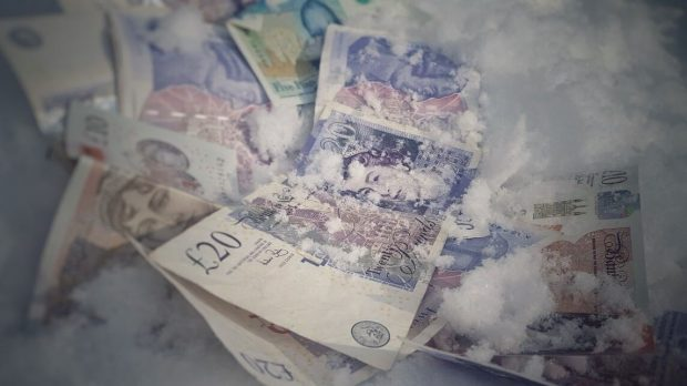 £20 notes lying in snow